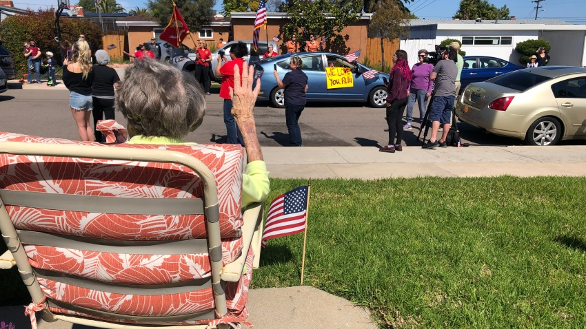 """Ruth Gallivan, 104, waves to the crowd who surprised her with a """"drive by"""" birthday party."""