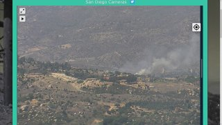 Smoke from a brush fire is visible from the Mt. Woodsoon SDG&E camera on Sunday, July 5, 2020.