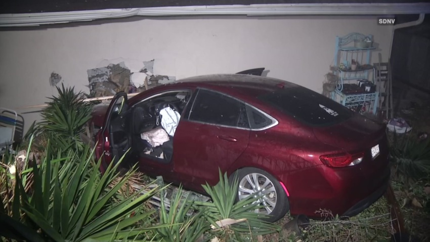 Red car slams into Rancho Bernardo home