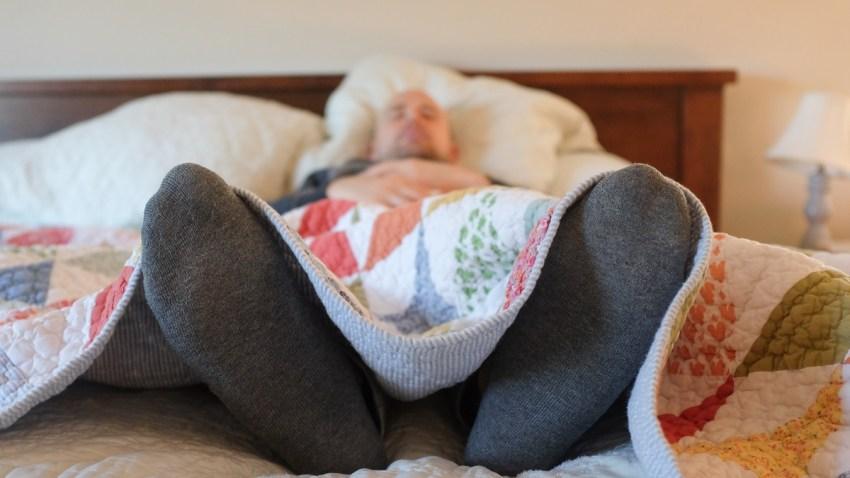 Man asleep in bed.