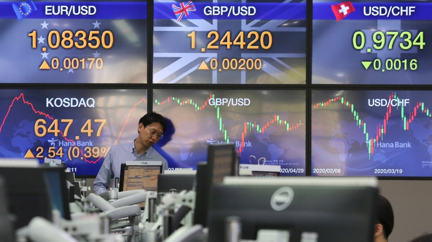 A currency trader watches monitors at the foreign exchange dealing room of the KEB Hana Bank headquarters in Seoul, South Korea on April 29, 2020.