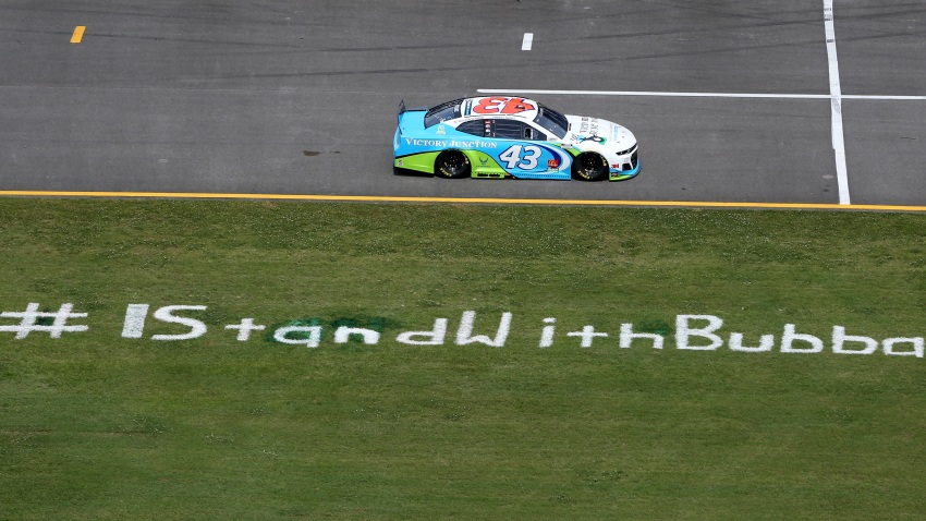 Bubba Wallace, driver of the #43 Victory Junction Chevrolet, drives past the #IStandWithBubba stencil on the field prior to the NASCAR Cup Series GEICO 500 at Talladega Superspeedway on June 22, 2020 in Talladega, Alabama. A noose was found in the garage stall of NASCAR driver Bubba Wallace at Talladega Superspeedway a week after the organization banned the Confederate flag at its facilities.