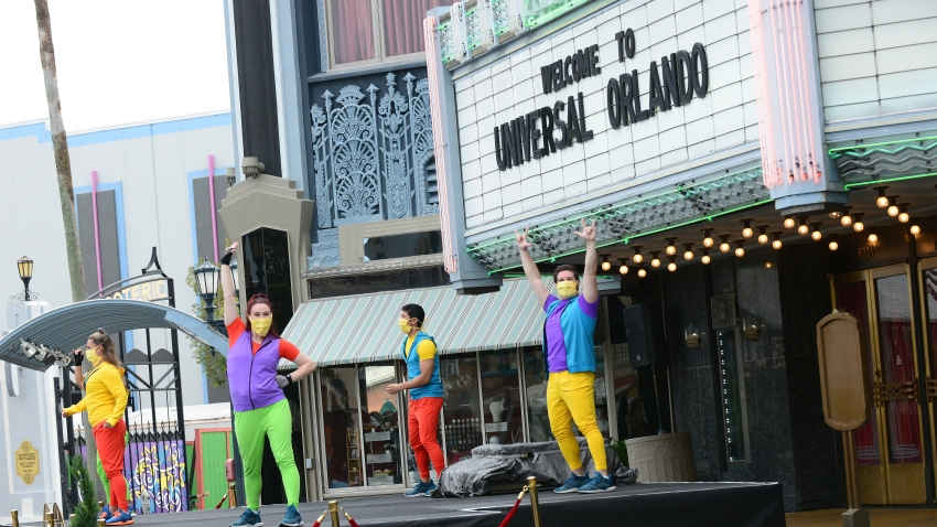 Universal Studio cast members perform during the first day of reopening from the coronavirus pandemic at Universal Orlando Resort, June 5, 2020, in Orlando, Fla.