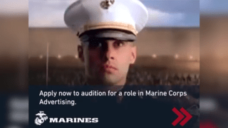 """A uniformed Marine looks straight at the camera. Across the bottom of the photo, it reads, """"Apply now to audition for a role in Marine Corps advertising."""""""
