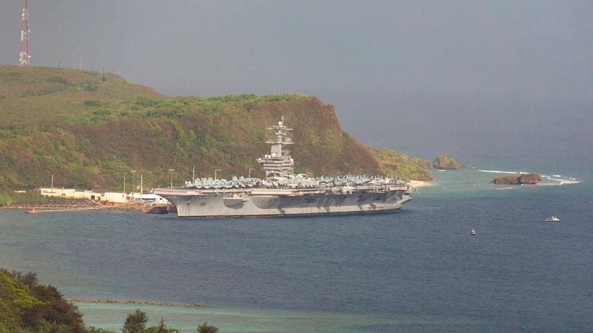 The aircraft carrier USS Theodore Roosevelt is docked at Naval Base Guam in Apra Harbor amid the coronavirus pandemic, April 27, 2020.