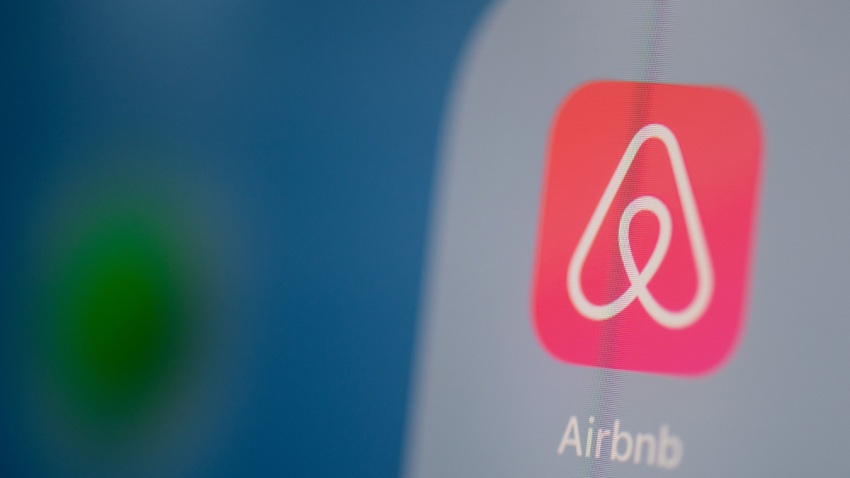 This photo illustration dated July 24, 2019, shows the logo of the online booking application Airbnb on the screen of a tablet.