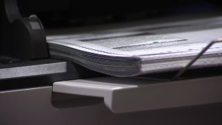 A new, high-speed scanner in San Diego County can count 4,000 ballots per hour.
