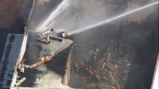 Fire tears through warehouse