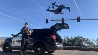 A Chula Vista Police Department officer with one of the department's drones.