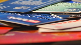 Stack of unidentifiable credit cards on a table