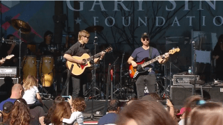 Actor Gary Sinise performing with the Lt. Dan Band