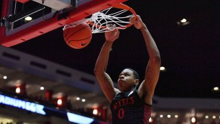 Keshad Johnson of the San Diego State Aztecs dunks against the New Mexico Lobos