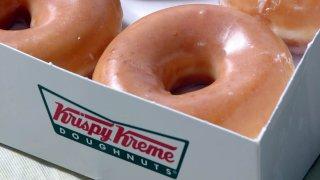 In this Nov. 10, 2004, file photo, Krispy Kreme glazed doughnuts are shown in Charlotte, North Carolina.