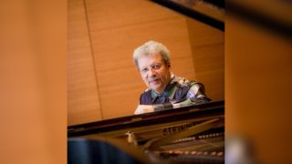 UCSD's Anthony Davis seated at piano