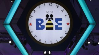 """In this May 30, 2019, file photo, Blake Bouwman of Grand Rapids, Michigan, tries to spell the word """"coelogyne"""" during round eight of the Scripps National Spelling Bee at the Gaylord National Resort & Convention Center in National Harbor, Maryland."""