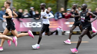 Kenya's Eliud Kipchoge (white jersey) runs during his attempt to bust the mythical two-hour barrier for the marathon on October 12 2019 in Vienna. - Kipchoge holds the men's world record for the distance with a time of 2hr 01min 39sec, which he set in the flat Berlin marathon on September 16, 2018. He tried in May 2017 to break the two-hour barrier, running on the Monza National Autodrome racing circuit in Italy, failing narrowly in 2hr 00min 25sec.