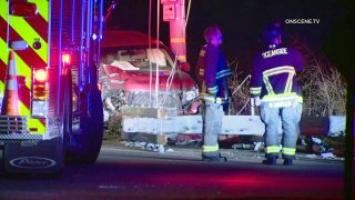 Car hits light pole