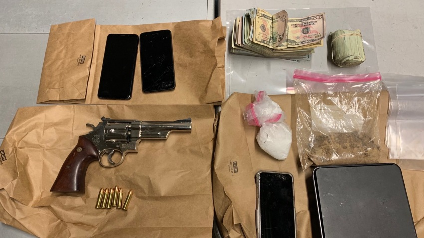 A gun, drugs, and cash were seized by police