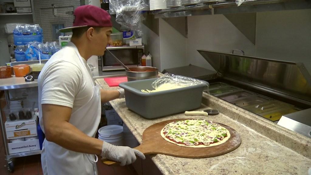 Chef preparing pizza in Poway