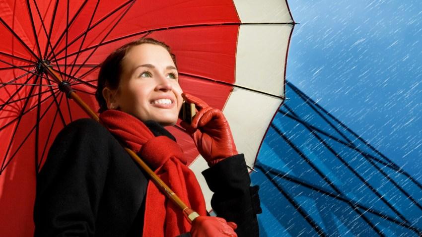 rain_woman with umbrella_Andrejs Pidjass