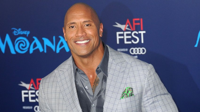 "In this Nov. 14, 2016, file photo, actor Dwayne Johnson arrives for the AFI FEST 2016 Presented By Audi - Premiere Of Disney's ""Moana"" held at the El Capitan Theatre in Hollywood, California."