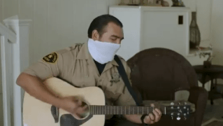 San Diego Sheriff's Department Deputy Roland Garza serenades senior citizens as part of the department's You Are Not Alone program.