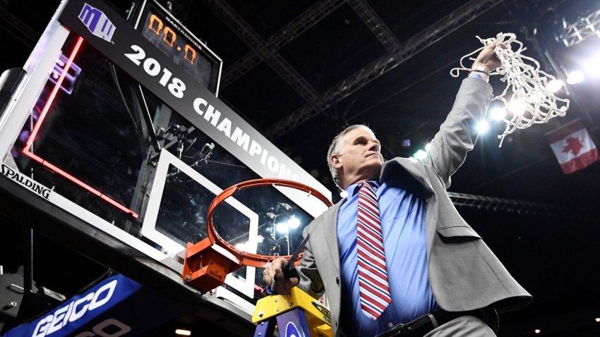 Brian Dutcher cutting down basketball net