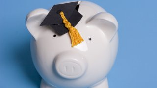 generic college salary piggy bank graduation cap
