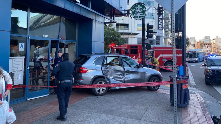 SUV Crashes Into Downtown Starbucks After Hitting Semi Truck