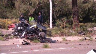 Investigators inspect car crash