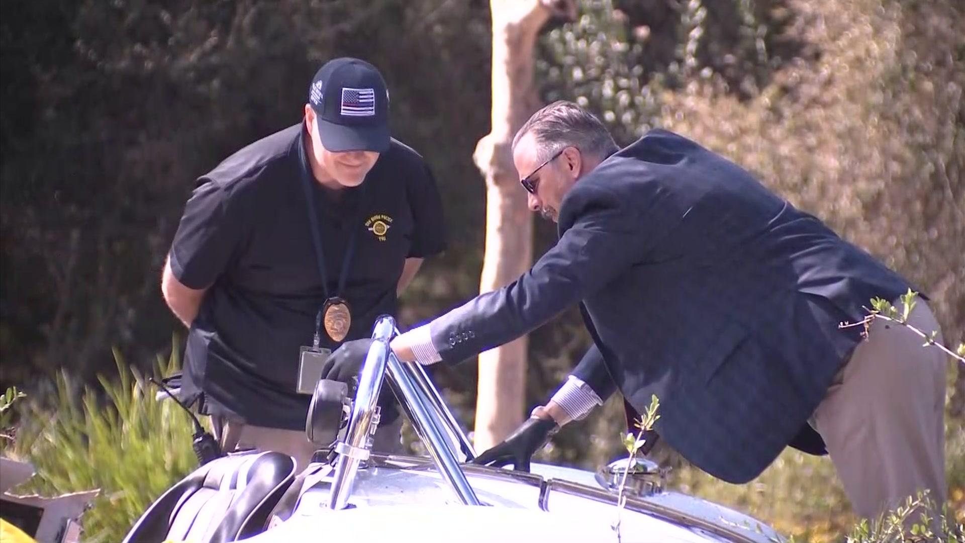 Investigators inspect crash