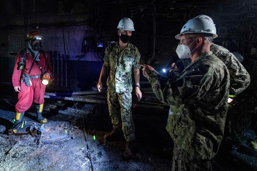 Admiral Mike Gilday (right), the chief of naval operations, visited San Diego to inspect the USS Bonhomme Richard – where a fire that took four days to battle was one of the worst to rip through a U.S. warship outside of combat in recent years, according to Navy officials.