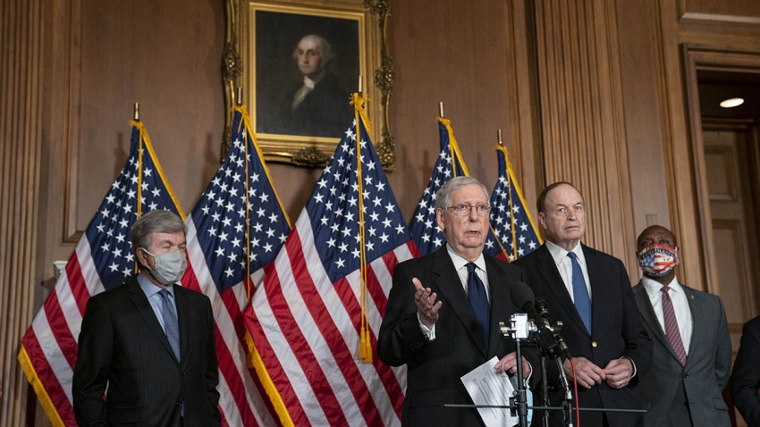Senate Majority Leader Mitch McConnell, second left, speaks during a press conference at the U.S. Capitol in Washington, D.C., July 27, 2020.