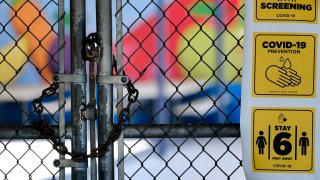 A chain-link fence lock is seen on a gate at a closed Ranchito Elementary School in the San Fernando Valley section of Los Angeles on Monday, July 13, 2020. Amid spiking coronavirus cases, Los Angeles Unified School District campuses will remain closed when classes resume in August, Superintendent Austin Beutner said Monday.