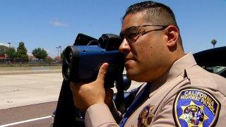 CHP Officer with speeding gun on State Route 163 in San Diego