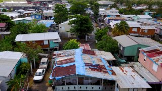 The blue tarp that was used to protect the roof damaged by Hurricane Maria two years ago is showing wear and tear