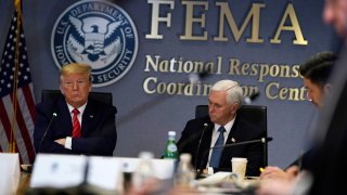 WASHINGTON, DC - MARCH 19: President Donald Trump (L) and Vice President Mike Pence attend a teleconference with governors at the Federal Emergency Management Agency headquarters on March 19, 2020 in Washington, DC. With Americans testing positive from coronavirus rising President Trump is asking Congress for $1 trillion aid package to deal with the COVID-19 pandemic.