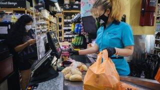 Grocery worker wears a face mask