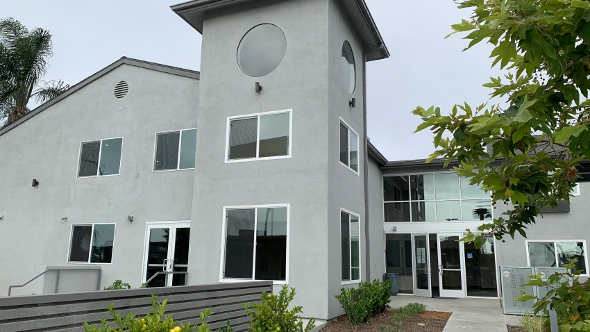 An exterior view of a newly renovated transitional housing for homeless families and individuals.