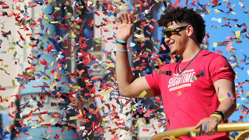 Under a shower of confetti, Kansas City Chiefs quarterback Patrick Mahomes waves to cheering fans during a parade in the team's honor at the Magic Kingdom at Walt Disney World, in Lake Buena Vista, Fla., Feb. 2, 2020.