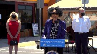 San Diego City Councilwoman Monica Montgomery (at podium)