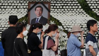 Mourners pass by a memorial altar for late Seoul Mayor Park Won-soon at City Hall Plaza in Seoul, South Korea, Sunday, July 12, 2020. The sudden death of Seoul's mayor, reportedly implicated in a sexual harassment complaint, has prompted an outpouring of public sympathy even as it has raised questions about a man who built his career as a reform-minded politician and self-described feminist.
