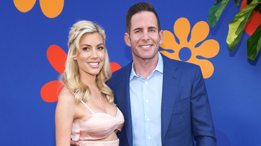 "In this Sept. 5, 2019, file photo, Tarek El Moussa and Heather Rae Young attend the premiere of HGTV's ""A Very Brady Renovation"" at The Garland Hotel in North Hollywood, California."
