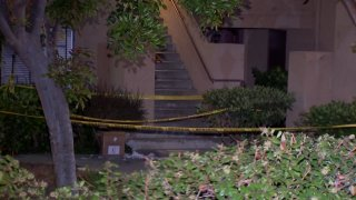 an apartment surrounded by caution tape