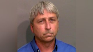 """This booking photo provided by the Glynn County Sheriff's Office shows William """"Roddie"""" Bryan Jr., who was jailed Thursday, May 21, 2020, in Brunswick, Ga., on charges of felony murder and attempted false imprisonment."""