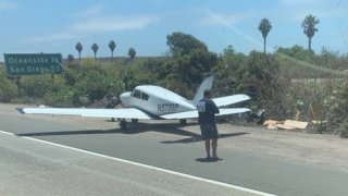 A small plane on the shoulder of I-5 near Camp Pendleton