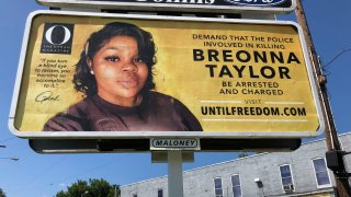 A billboard sponsored by O, The Oprah Magazine, is on display with a photo of Breonna Taylor
