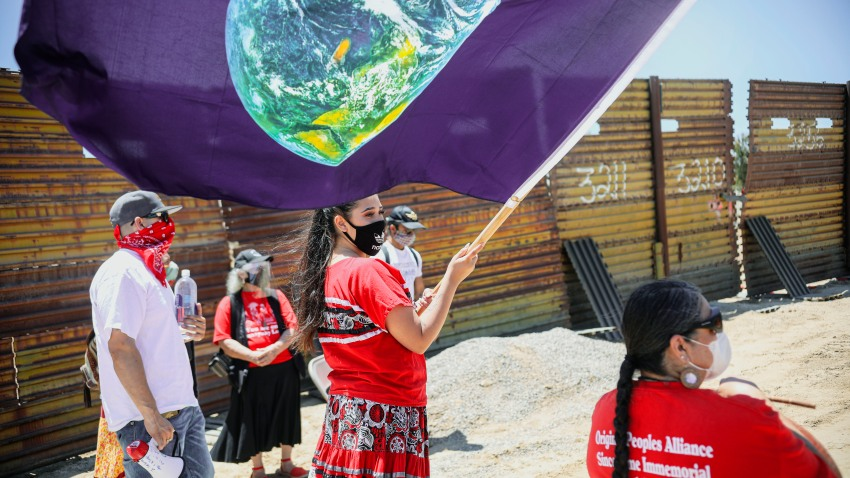 Members of the Kumeyaay band of Indians and demonstrators rally at the United States-Mexico border to protest construction of new wall on their ancestral grounds, July 1, 2020, in Boulevard, Calif.