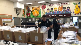 National City Police officers getting bags of school supplies organized at John Otis Elementary School on Thursday morning.