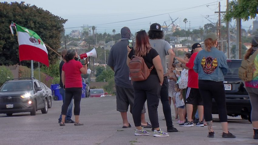 A group gathers to protest U.S. Border Patrol's presence in the Grant Hill neighborhood.